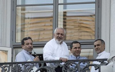(From L) Iranian Deputy Foreign Minister Abbas Araqchi, Iranian Foreign Minister Mohammad Javad Zarif, Iran's deputy foreign minister for European and American Affairs, Majid Takht-Ravanchi, and Hossein Fereydoun, the brother of the Iranian president gather onto a balcony of the Palais Coburg Hotel, where the Iran nuclear talks meetings are being held in Vienna on July 11, 2015.  (AFP PHOTO / JOE KLAMAR)