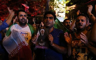 Iranians celebrate in northern Tehran, on July 14, 2015, after Iran's nuclear negotiating team struck a deal with world powers in Vienna. (AFP Photo/Atta Kenare)