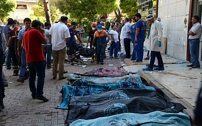 The bodies of victims after a suicide bombing in the Turkish town of Suruc, not far from the Syrian border, July 20, 2015 (AFP/Ilyas Akengin)