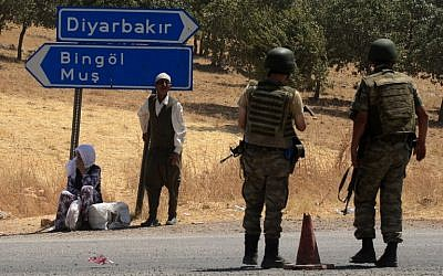 Illustrative: Turkish soldiers wait at a check point in Diyarbakir on July 26, 2015. (AFP/Ilyas Akengin)