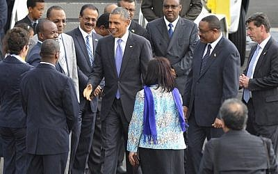 US President Barack Obama (center) greets Ethiopian government officials upon his arrival at Bole International Airport in Addis Ababa on July 26, 2015. (AFP/Simon Maina)