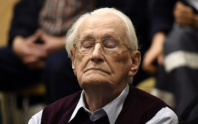 """Convicted former SS officer Oskar Groening listens to the verdict of his trial on July 15, 2015 at court in Lueneburg, northern Germany. Oskar Groening, 94, sat impassively as judge Franz Kompisch said """"the defendant is found guilty of accessory to murder in 300,000 legally connected cases"""" of deported Jews who were sent to the gas chambers in 1944. (AFP PHOTO/TOBIAS SCHWARZ)"""