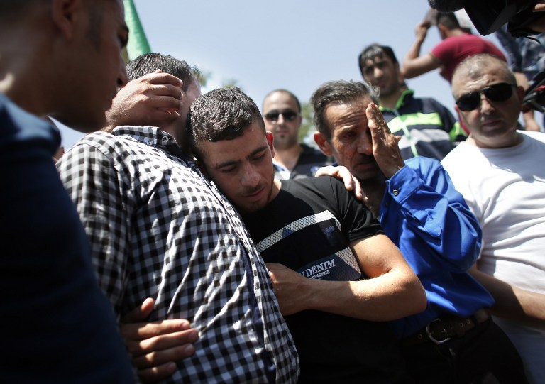 Relatives mourn during the funeral of 18-month-old Palestinian toddler Ali Saad Dawabsha, who died after his house was set on fire in an attack by suspected Jewish terrorists, in the West Bank village of Duma on July 31, 2015. (AFP PHOTO / THOMAS COEX)