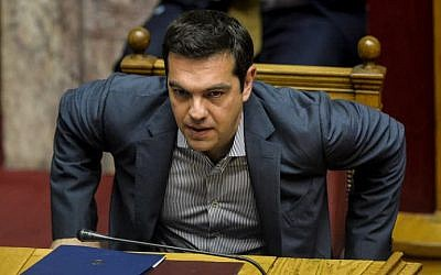 Greek Prime Minister Alexis Tsipras takes part at a joint session of four committees of the Parliament (Economic, Social, Public Administration and Production and Trade) at the Greek Parliament in Athens on July 10, 2015. (AFP/ANDREAS SOLARO)