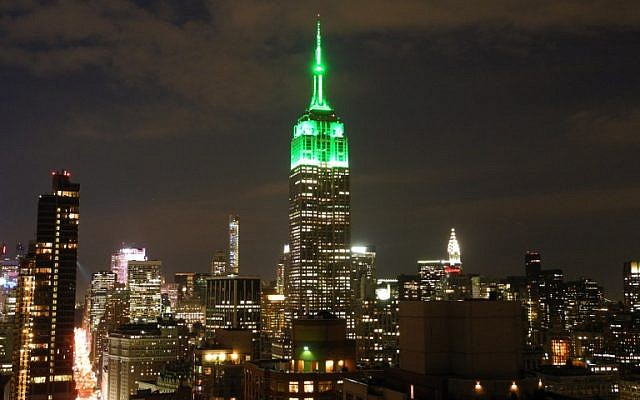 The Empire State Building is lit in green July 17, 2015 in New York City to celebrate the Eid al-Fitr holiday that marks the end of Ramadan. (AFP PHOTO/BRIGITTE DUSSEAU)