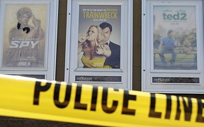 A poster of  of Amy Schumer's movie  Trainwreck (C) is seen on July 25, 2015 outside The Grand Theatre in Lafayette, Louisiana (Yuri Gripad/AFP)