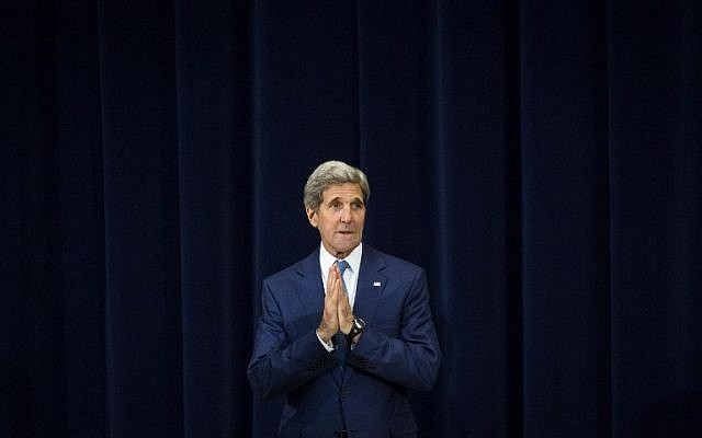 """John Kerry gestures during an event releasing the """"2015 Trafficking in Persons Report,"""" at the US State Department, July 27, 2015 in Washington, DC. (Drew Angerer/Getty Images/AFP)"""