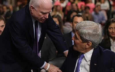 Senate Armed Services Committee John McCain (R-AZ) (L) talks briefly with Secretary of State John Kerry during a break in a hearing about the nuclear deal struck between Iran and six nations, including the United States, on Capitol Hill July 29, 2015 in Washington, DC (Chip Somodevilla/Getty Images/AFP)