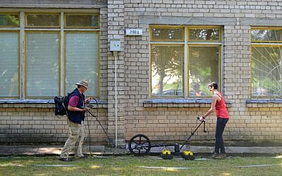 Archaeologists conducting a Ground Penetrating Radar survey at the site of the Great Synagogue of Vilna in Lithuania, June 2015. (Jon Seligman, Courtesy of the Israel Antiquities Authority)