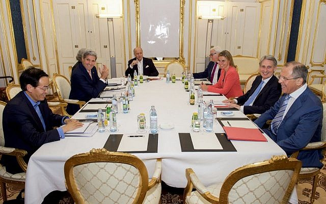 US Secretary of State John Kerry sits with Chinese Ambassador Cheng Jingye, bottom left, US Energy Secretary of Energy Dr. Ernest Moniz, French Foreign Minister Laurent Fabius, German Foreign Minister Frank-Walter Steinmeier, European Union High Representative for Foreign Affairs Federica Mogherini, British Foreign Secretary Philip Hammond, and Russian Foreign Minister Sergey Lavrov at the Palais Coburg Hotel in Vienna, Austria, in the early morning hours of July 14, 2015. (US State Department)