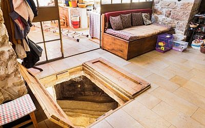 A trap door in the Shimshoni's living room opening up to a ancient ritual bath. (Assaf Peretz/courtesy Israel Antiquities Authority)