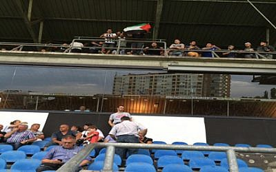 Fans of Sporting Charleroi flying a Palestinian flag, in a photo published by Beitar Jerusalem management following a soccer match between Beitar and Sporting in Belgium, on Thursday July 16 2015 (Beitar Jerusalem)
