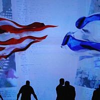 Workers prepare the stage before Israeli Prime Minister Benjamin Netanyahu's address to the AIPAC 2015 Policy Conference on March 2, 2015. (Mark Wilson/Getty Images/JTA)