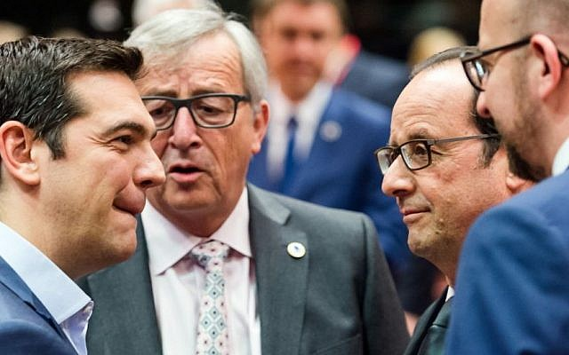 Greek Prime Minister Alexis Tsipras, left, speaks with, from left, European Commission President Jean-Claude Juncker, French President Francois Hollande and Belgian Prime Minister Charles Michel during a meeting of eurozone heads of state at the EU Council building in Brussels on Sunday, July 12, 2015. (AP/Geert Vanden Wijngaert)