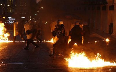Riot police try to avoid petrol bombs during clashes in Athens, Wednesday, July 15, 2015. (AP/Emilio Morenatti)