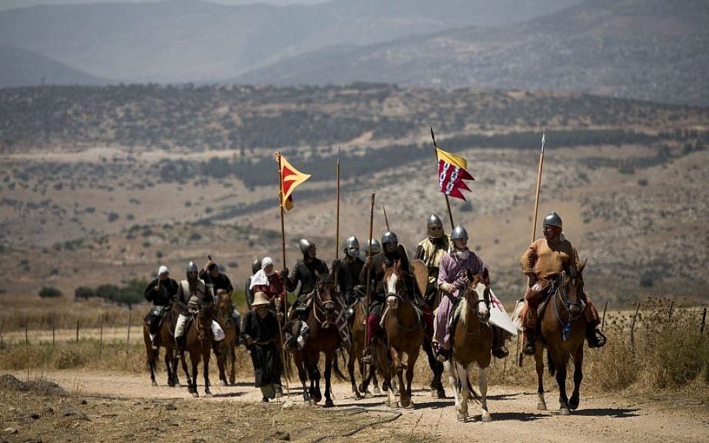 Israeli and Russian members of knight clubs, ride their horses on their way to the reenactment of the Battle of Hattin in the Horns of Hattin, northern Israel, July 4, 2015 (AP/Oded Balilty)