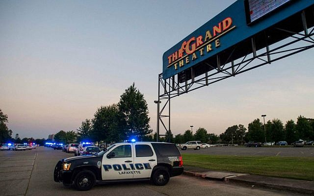 A Lafayette Police Department vehicle blocks an entrance at the Grand Theatre in Lafayette, Louisiana, following a shooting,  July 23, 2015. (Paul Kieu/The Daily Advertiser via AP)