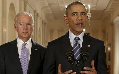 President Barack Obama, standing with Vice President Joe Biden, delivers remarks in the East Room of the White House in Washington, Tuesday, July 14, 2015, after an Iran nuclear deal is reached. (AP Photo/Andrew Harnik, Pool)