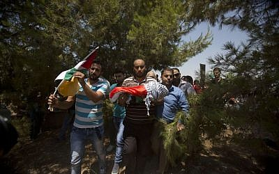 Palestinians carry the body of one-and-a-half year old Ali Dawabsha, killed in an apparent 'price tag' attack, during his funeral in Duma village near the West Bank city of Nablus, Friday, July 31, 2015. (AP Photo/Majdi Mohammed)