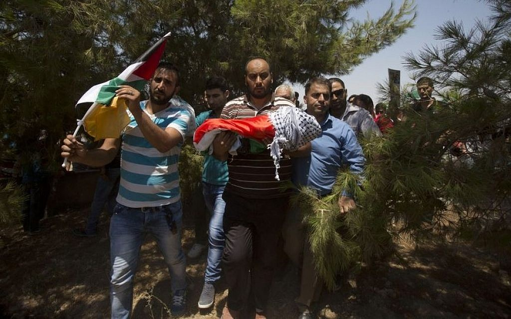 Palestinians carry the body of one-and-a-half year old Ali Dawabsha during his funeral in Duma village near the West Bank city of Nablus, Friday, July 31, 2015. The infant was burned to death in an apparent 'price tag' attack by Jewish terrorists. (AP Photo/Majdi Mohammed)