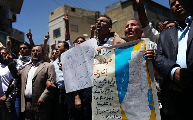 Protesters chant slogans against Israel to condemn its bombing of Gaza and demanding Hamas and other Palestinian brigades in Gaza reject any truce with Israel, during a protest by followers of the Muslim Brotherhood in Amman, Jordan, Friday, July 18, 2014 (AP/Mohammad Hannon)