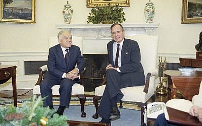 US president George H. Bush meets with prime minister Yitzhak Shamir in the Oval Office of the White House in Washington on Tuesday, December 11, 1990 (AP Photo/Barry Thumma, File)