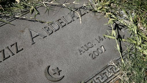 A grave marker with a family name sits planted in the Islamic Garden, a burial site for members of the Muslim faith, that is part of the Restland Cemetery Friday, July 17, 2015, in Dallas. (Tony Gutierrez/AP)