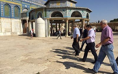 Knesset members from the Joint (Arab) List walk outside the Dome of the Rock at the Temple Mount in Jerusalem on Tuesday, July 28, 2015 (courtesy)