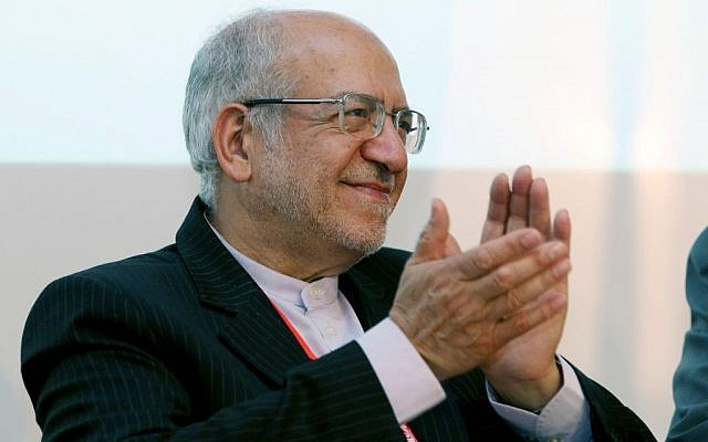 """Mohammad Reza Nematzadeh, Minister of Industry, Mine and Trade of Iran applauds during the """"Iran-EU conference, Trade and Investment"""" forum in Vienna, Austria, Thursday, July 23, 2015. (AP Photo/Ronald Zak)"""