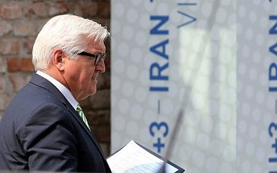 German Foreign Minister Frank-Walter Steinmeier leaves Palais Coburg where closed-door nuclear talks with Iran took place in Vienna, Austria, Thursday, July 2, 2015. (AP Photo/Ronald Zak)