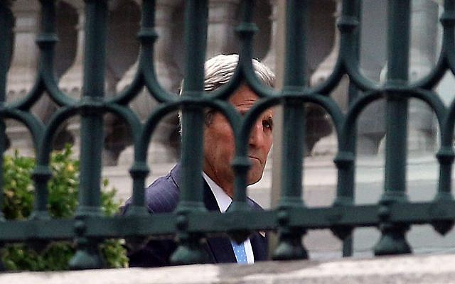 US Secretary of State John Kerry walks in the garden of Coburg where closed-door nuclear talks with Iran take place in Vienna, Austria, Sunday July 12, 2015. (AP/Ronald Zak)