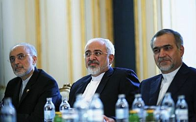 Iranian Foreign Minister Mohammad Javad Zarif, center, Head of the Iranian Atomic Energy Organization Ali Akbar Salehi, left, and Hossein Fereydoon, brother and close aide to President Hassan Rouhani, meet with U.S. Secretary of State John Kerry in Vienna, Austria, Friday July 3, 2015. (Carlos Barria/Pool via AP)
