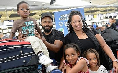 Aaron and Tracy Beavers and family at John F. Kennedy Airport in New York on their way to Israel to make aliyah, July 13, 2015. (Courtesy of Shahar Azran/Nefesh B'Nefesh/JTA)