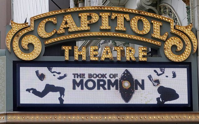 "The Capitol Theatre marquee displays the ""Book of Mormon"" musical, Monday, July 27, 2015, in Salt Lake City. (AP Photo/Rick Bowmer)"