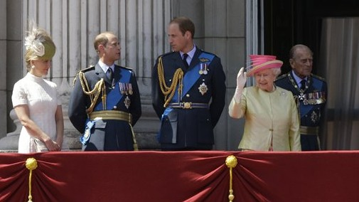 Britain's Queen Elizabeth II, fourth left, waves beside from left, Sophie Countess of Wessex, Prince Edward, Prince William and her husband Prince Philip after they watched a Royal Air Force flypast to mark the 75th anniversary of the Battle of Britain from a balcony at Buckingham Palace, in London, Friday, July 10, 2015 (AP Photo/Matt Dunham)