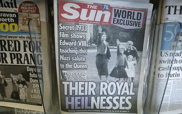 A row of newspapers on display including a paper with a photo of Britain's Queen Elizabeth as a child giving a Nazi salute, in a shop, in London, Saturday July 18, 2015. (AP Photo/Tim Ireland)