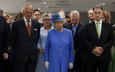 Britain's Queen Elizabeth II and the Duke of Edinburgh, left, stand during a tour of Strathclyde University's Technology and Innovation Centre in Glasgow, Scotland, as Britain remembers the victims of the Tunisia terror attack with a minute's silence, Friday, July 3, 2015. (Danny Lawson/PA via AP)