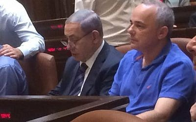 Likud's Yuval Steinitz. in casual dress, sitting next to Prime Minister Benjamin Netanyahu at the Knesset late Monday night, in a photo tweeted by Zionist Union MK Shelly Yacimovich. (Screen capture Twitter)
