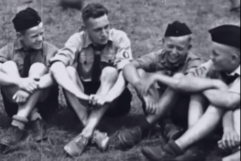 A counselor is surrounded by his charges at Camp Siegfried, near New York City, in 1937. (YouTube screenshot)