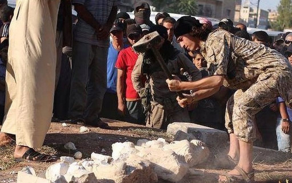 An Islamic State operative smashing statues in the Syrian city of Palmyra, July 2, 2015. (screen capture)