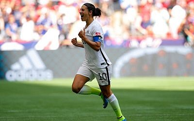 US soccer player Carli Lloyd celebrates scoring the opening goal against Japan in the FIFA Women's World Cup Canada 2015 Final, Vancouver, Canada, July 5, 2015. Kevin C. Cox/Getty Images)
