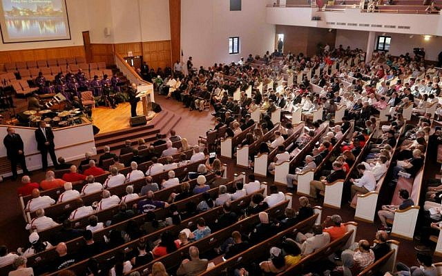 Supporters gather for an interfaith memorial service for the Tennessee shooting victims, Friday, July 17, 2015, in Chattanooga, Tennessee. (Doug Strickland/Chattanooga Times Free Press via AP)