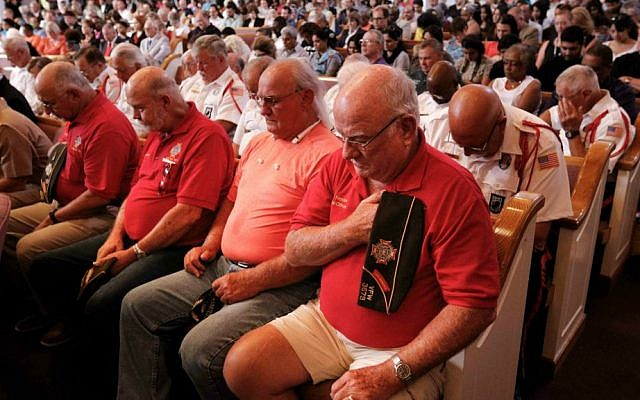 People bow their heads during an interfaith memorial service for the Tennessee shooting victims, Friday, July 17, 2015, in Chattanooga, Tennessee. (Doug Strickland/Chattanooga Times Free Press via AP)