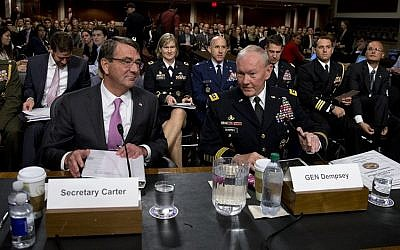 Chairman of the Joint Chiefs of Staff, Gen. Martin Dempsey, right, and Defense Secretary Ash Carter take their seats as they arrive at the Senate Armed Services Committee hearing, Washington, July 7, 2015. (AP/Carolyn Kaster)