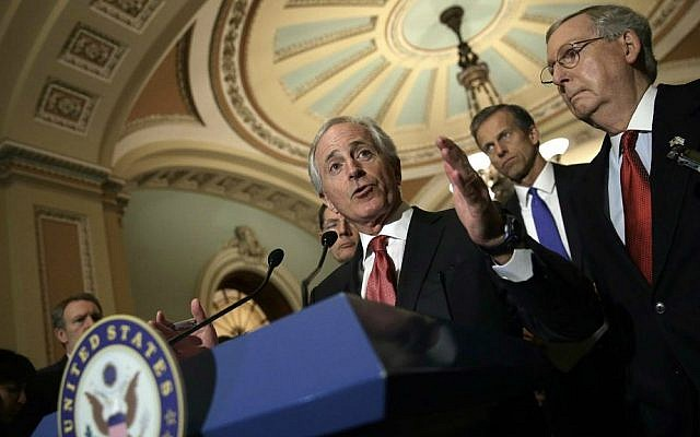 Sen. Bob Corker of Tennessee (center), the Foreign Relations Committee chairman, at a Washington news conference in March 2015. (Win McNamee/Getty Images via JTA)