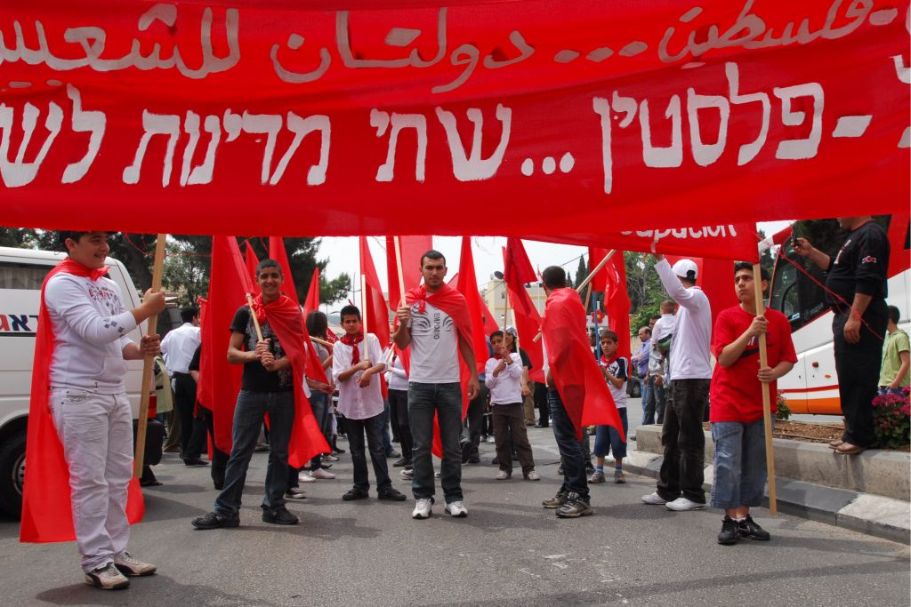 Members of the Israeli Hadash party, known for strong Israeli-Arab support and radically left leanings, march in Nazareth in 2009 for a two-state solution (Gili Yaari/Flash90)