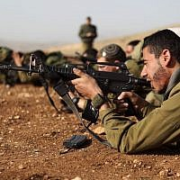 Illustrative: Soldiers in the IDF's ultra-Orthodox 'Netzah Yehuda' unit at the Peles Military Base in the northern Jordan Valley, August 2013. (Yaakov Naumi/Flash90)