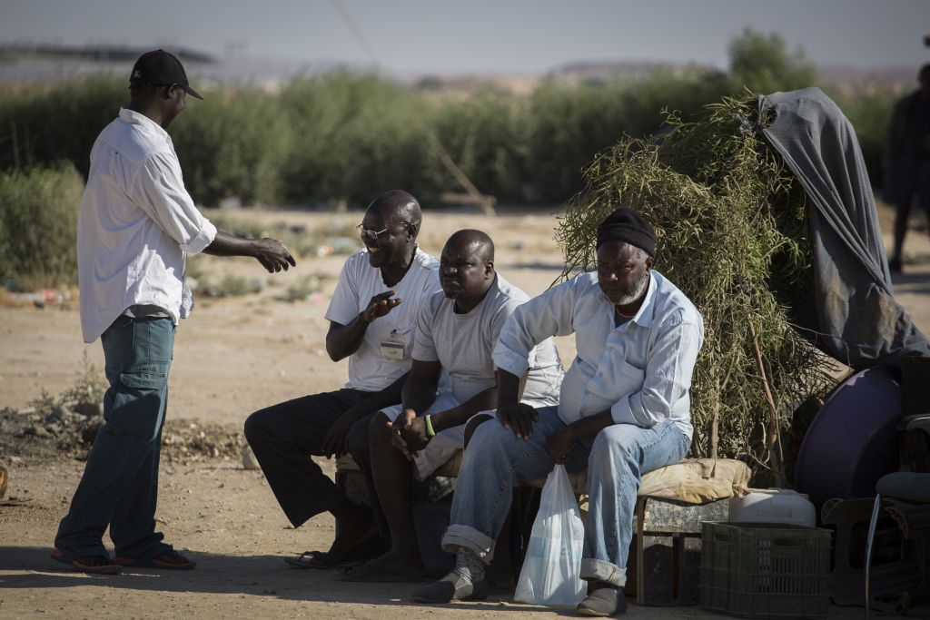 African refugees sit outside the Holot detention center in southern Israel, on June 13, 2015. (Hadas Parush/Flash90)