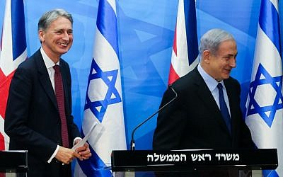 Prime Minister Benjamin Netanyahu with British Foreign Secretary Philip Hammond during a joint press conference at Netanyahu's office in Jerusalem on July 16, 2015. (Photo by Alex Kolomoisky/POOL)