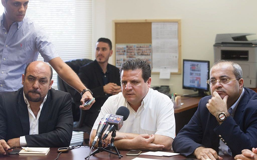 Joint (Arab) List leader MK Ayman Odeh is flanked by MKs Masud Ganaim (L) and Ahmad Tibi at the party's weekly meeting at the Knesset in Jerusalem on June 29, 2015 (Miriam Alster/Flash90)